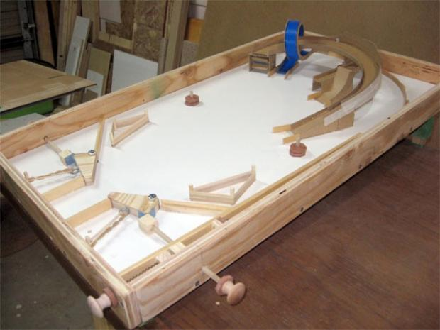 Man makes pinball table from scrap wood techcrunch for How to build a wooden table from scratch