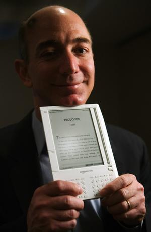 jeff-bezos-with-kindle
