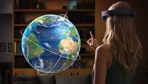 Microsoft HoloLens user interacting with a holographic globe.