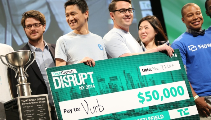 The Vurb team, including CEO Bobby Lo (second from left) celebrate their TechCrunch Disrupt Battlefield 2014 win