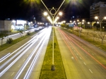 Picture of highway showing movement and streetlights.