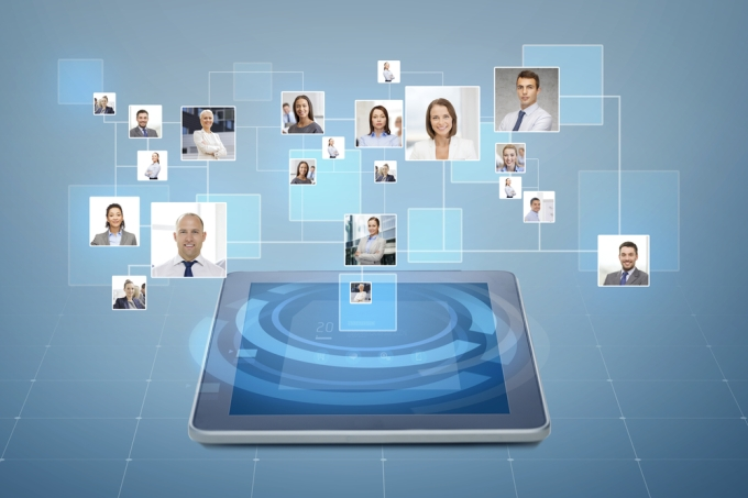 Network of people coming out of a tablet.