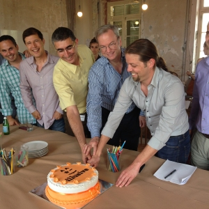 Eric Schmidt and Illusive Networks founders cut a cake at company headquarters in Israel.