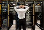 Man with hands on head looking at his servers.
