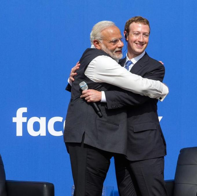 Zuckerberg embraces India's Prime Minister Narendra Modi, a Hindu