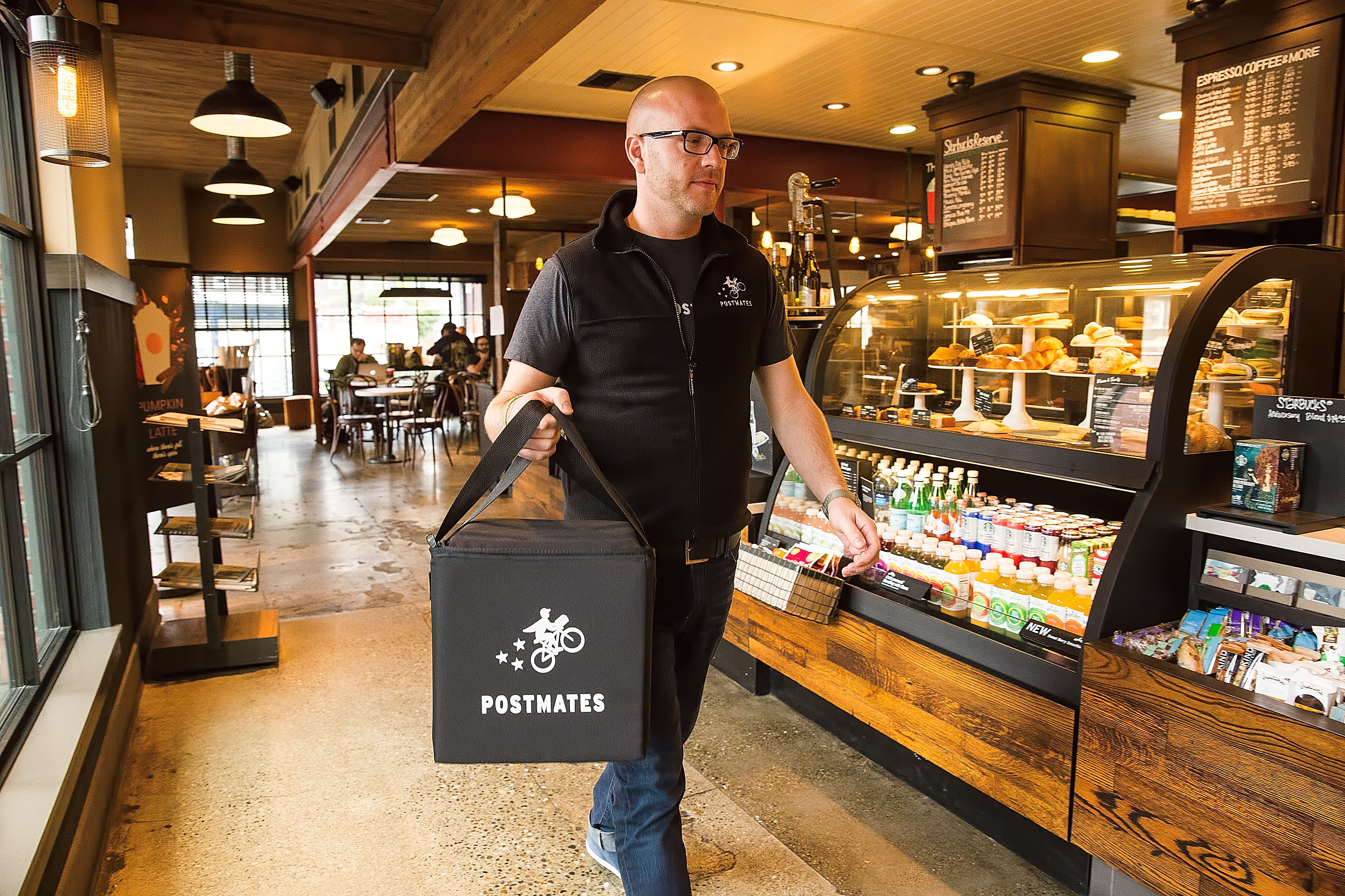 Postmates workers want minimum delivery guarantees and at least $15