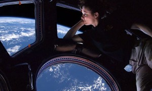 Astronaut Cady Coleman looking out window of the International Space Station / Image courtesy of NASA