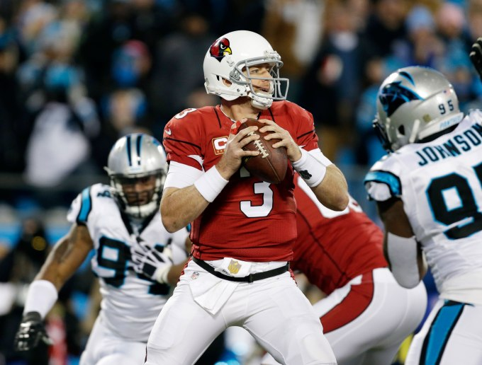 Arizona Cardinals' Carson Palmer drops back during the first half the NFL football NFC Championship game against the Carolina Panthers, Sunday, Jan. 24, 2016, in Charlotte, N.C. (AP Photo/Bob Leverone)