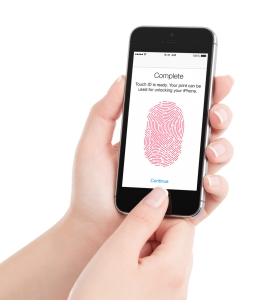 Finger completing Touch ID on iPhone.