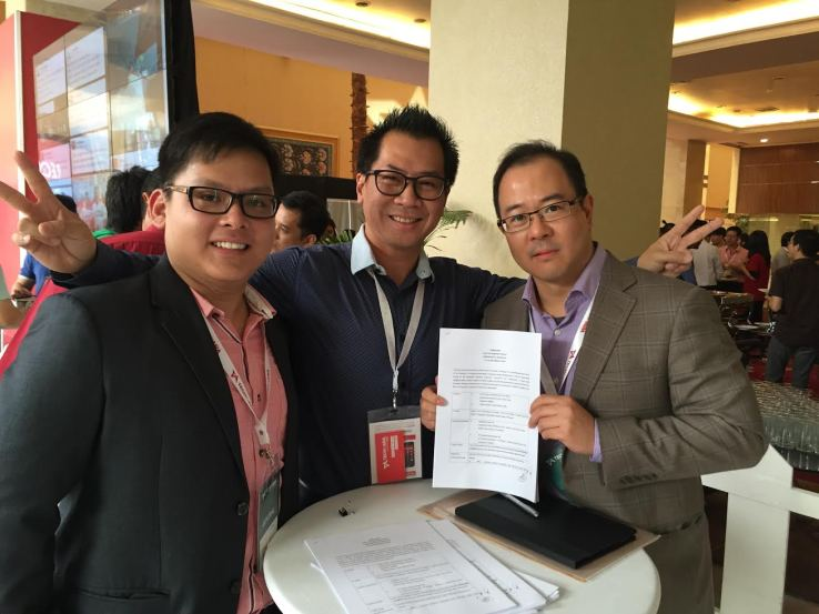 PicMix founder Calvin Kizana (center) with Gobi Partners' Victor Chua (left) and Thomas Tsao (right)