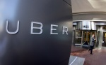 In this Dec. 16, 2015 file photo a man leaves the headquarters of Uber in San Francisco