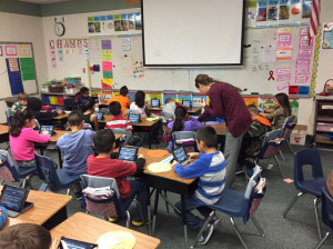 A teacher uses Nearpod to deliver digital curriculum to students' mobile devices, during class.