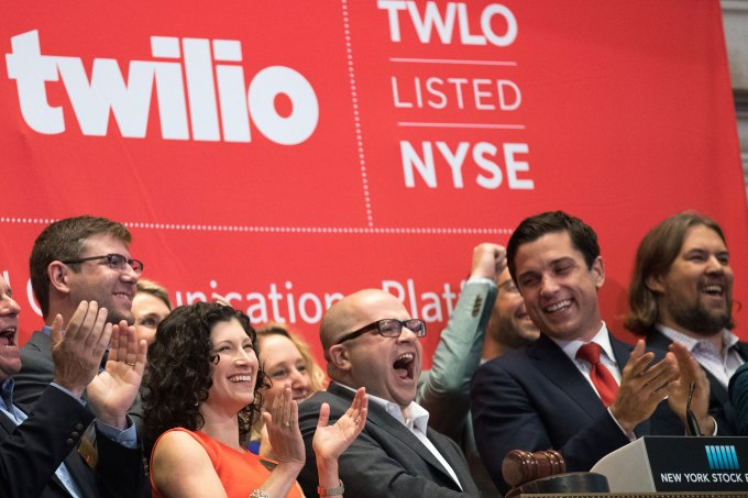 NEW YORK, NY - JUNE 23: Twilio Inc. founder and CEO Jeff Lawson (C, in glasses) reacts after ringing the opening bell to celebrate Twilio's initial public offering, at the New York Stock Exchange, June 23, 2016 in New York City. Financial markets are bracing for the outcome of Thursday's historic 'Brexit' referendum, where Britons will head to the polls to decide whether the United Kingdom should remain in the European Union. (Photo by Drew Angerer/Getty Images)