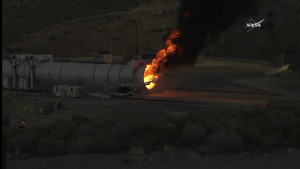 Robotic arm at the end of NASA's booster, extinguishing the flame / Screenshot from NASA livefeed