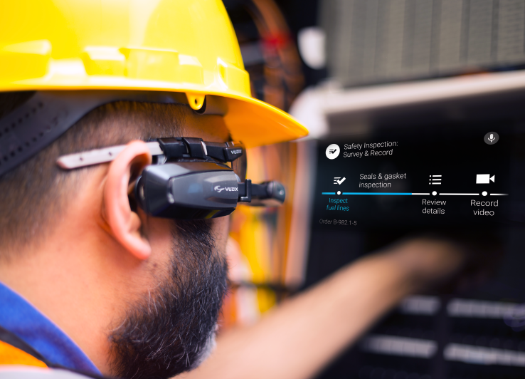 Worker wearing Vuzix smart glasses.