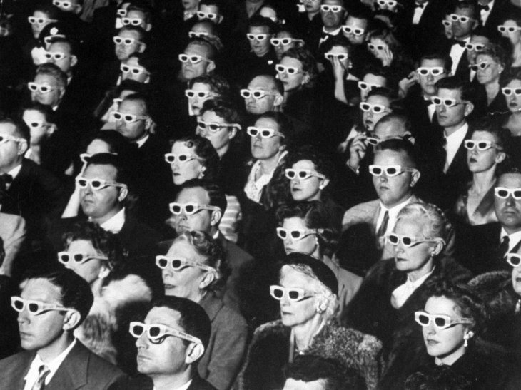 3-D Movie Viewers. Formally-attired audience sporting 3-D glasses during opening night screening of film Bwana Devil, the 1st full-length color 3-D (aka Natural Vision) motion picture, at Paramount Theater.