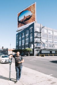 Jordan Ison in front of a billboard in San Francisco featuring his photo.