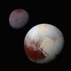 A composite image of Pluto (lower right) and its satellite Charon (upper left) / Image courtesy of NASA
