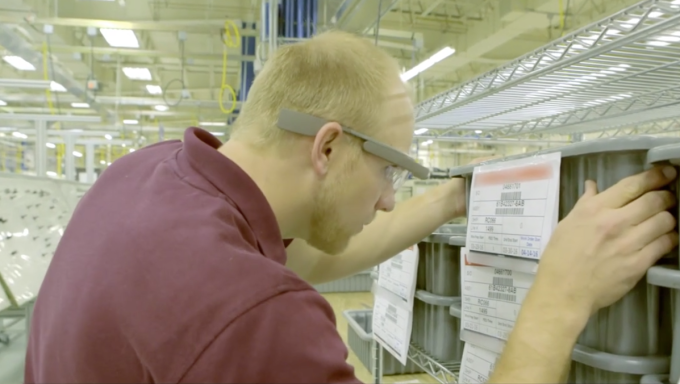 Boeing employee scans a code using Google Glass.