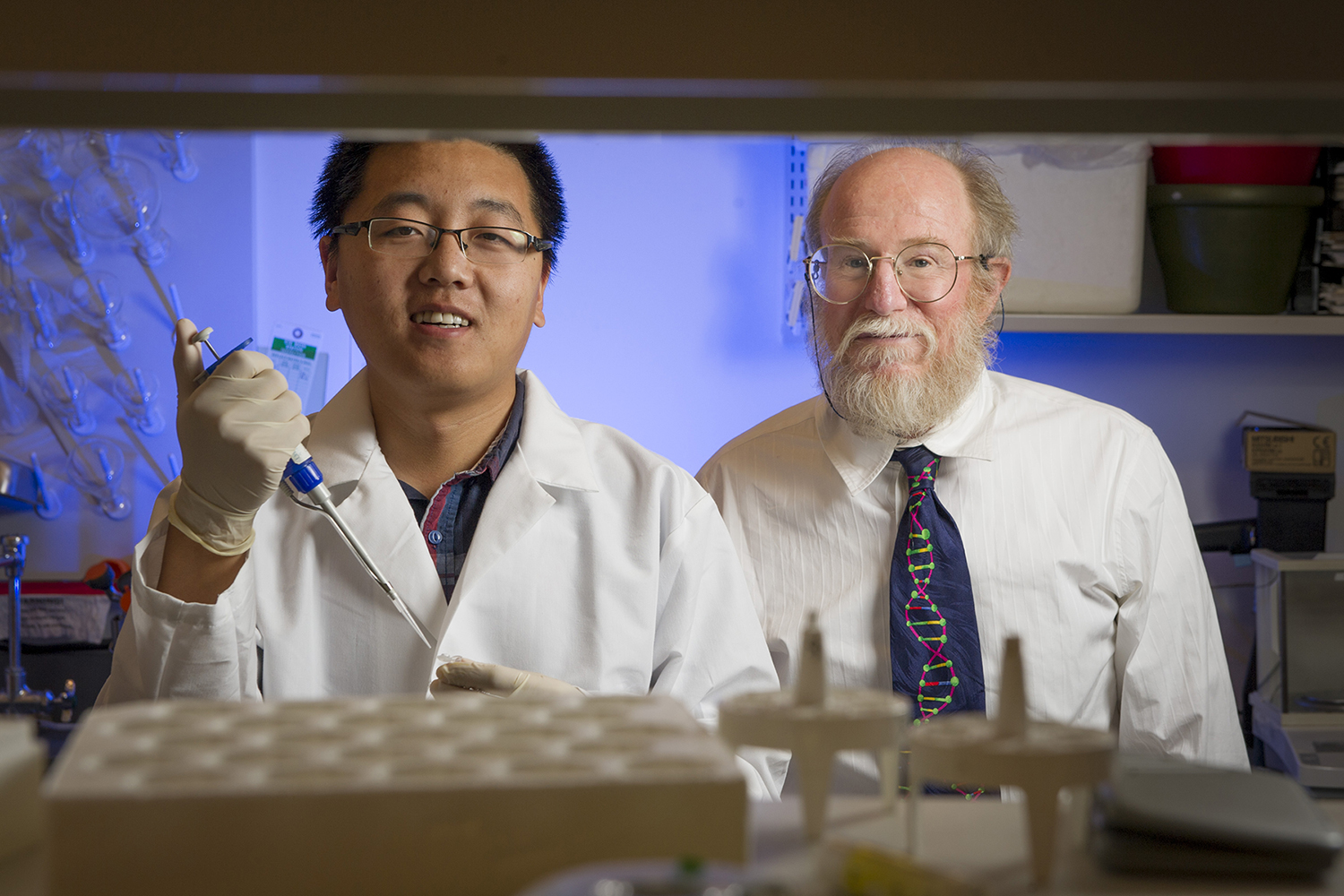 Graduate student Tianqi Song (left) and professor John Reif (right).