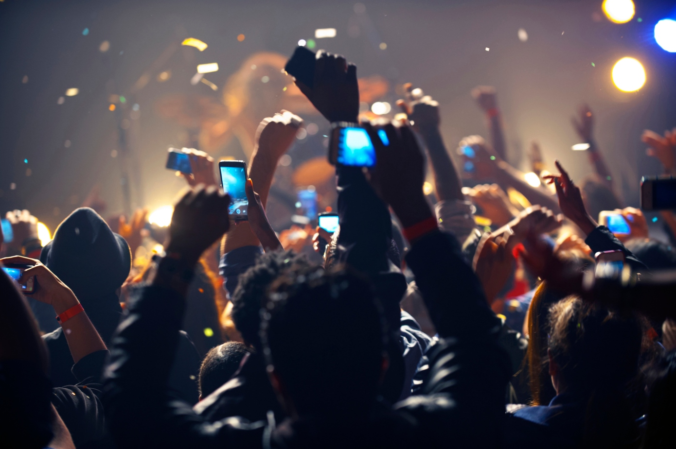 Fans hold up their phones during a concert