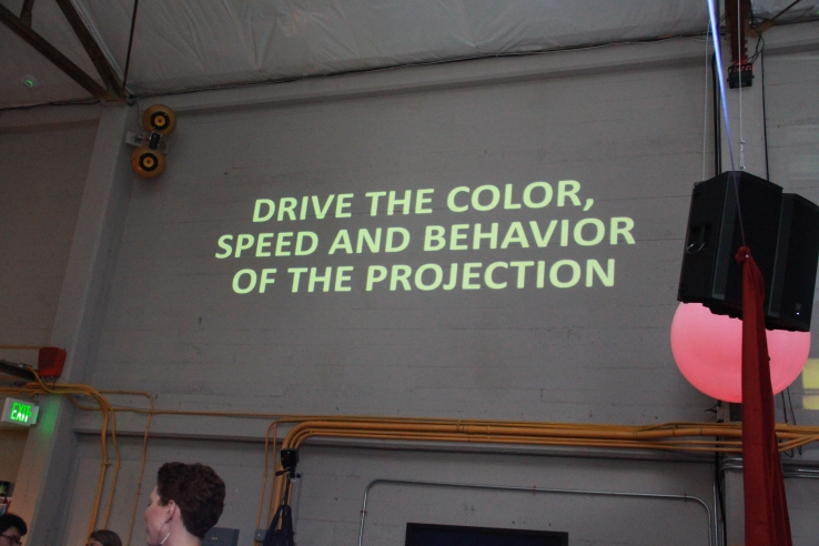 Saito Group demonstrated a poetry-generating projector at BuzzFeed Open Lab's Show and Tell.