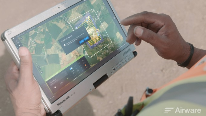 tablet-launching-commercial-drone-at-quarry