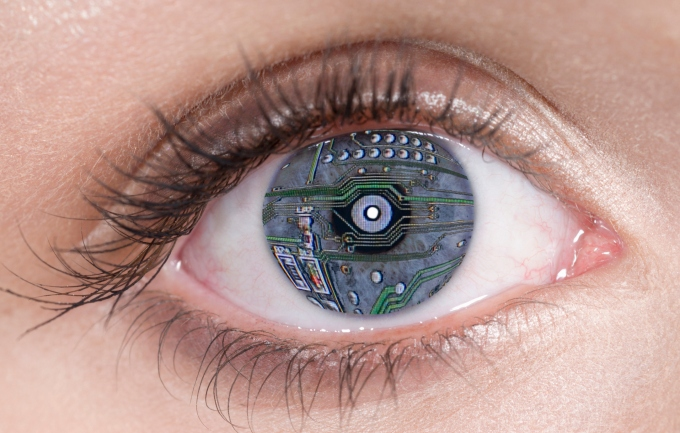 Close Up of blue eye with computer circuit board lines, digital composite
