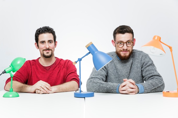 Signal Media's two founders and three desk lamps