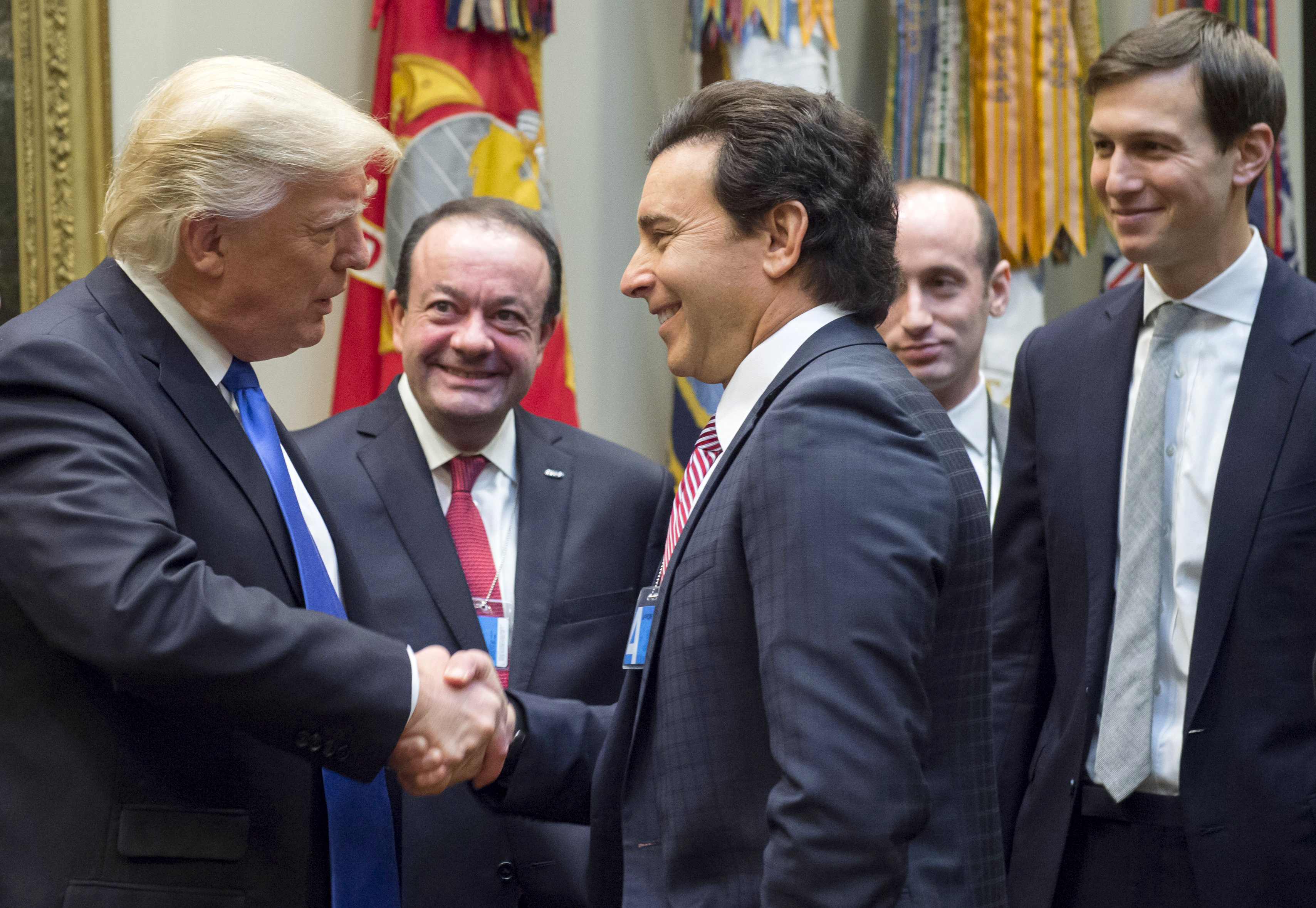 US President Donald Trump greets Ford President and CEO Mark Fields (C) prior to a meeting with automobile industry leaders in the Roosevelt Room of the White House in Washington, DC, January 24, 2017. (Photo: SAUL LOEB/AFP/Getty Images)
