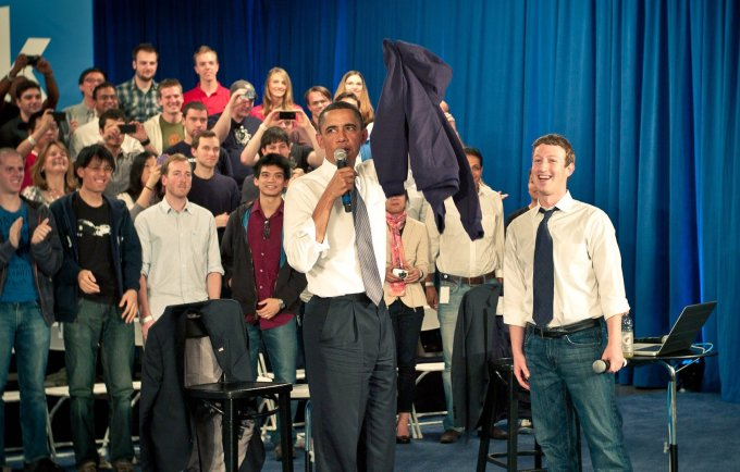 Zuckerberg leads a town hall meeting at Facebook's headquarters with President Obama in 2011