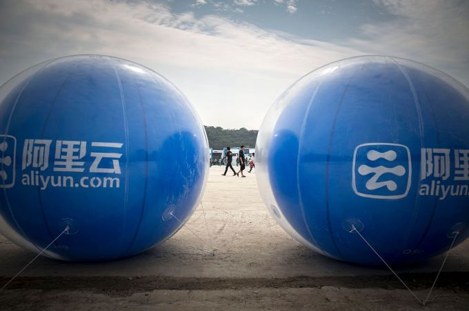 Giant balloons promoting AliCloud, the cloud-computing arm of Alibaba Group Holding Ltd., stand on display at the 2015 Computing Conference in Hangzhou, China, on Wednesday, Oct. 14, 2015. Alibaba's bet on data technology is driving greater investment in areas including ways to protect user privacy as it battles Amazon.com Inc. for customers globally. Photographer: Qilai Shen/Bloomberg via Getty Images