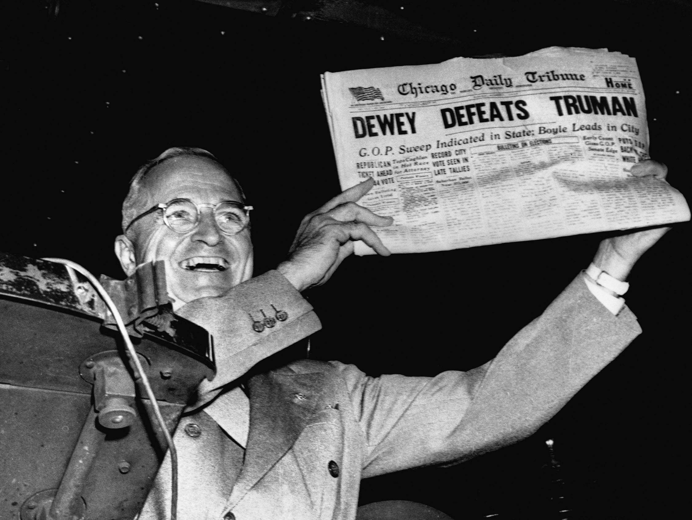 "Truman Waving ""Dewey Defeats Truman"" Headline"