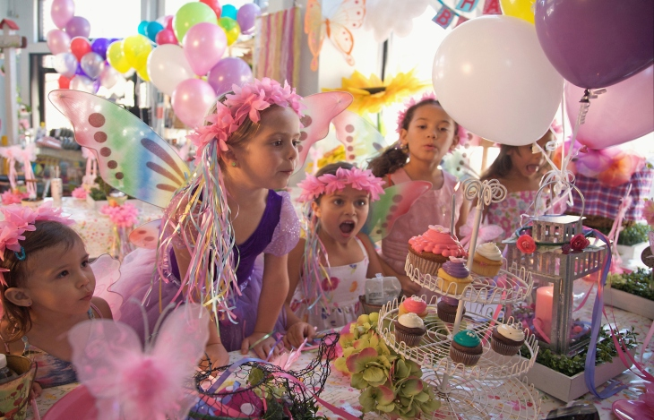 Party city invests 4 million in punchbowl which now powers its girl blowing out birthday candle party city filmwisefo