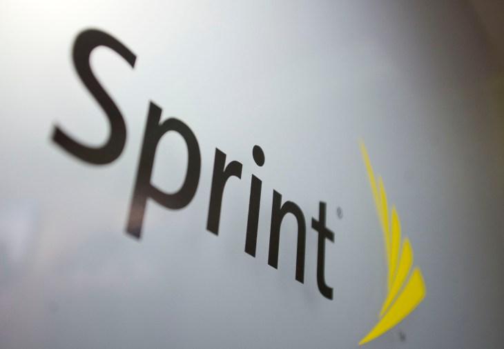 A Sprint Nextel Corp. logo is seen inside a store in New Yor