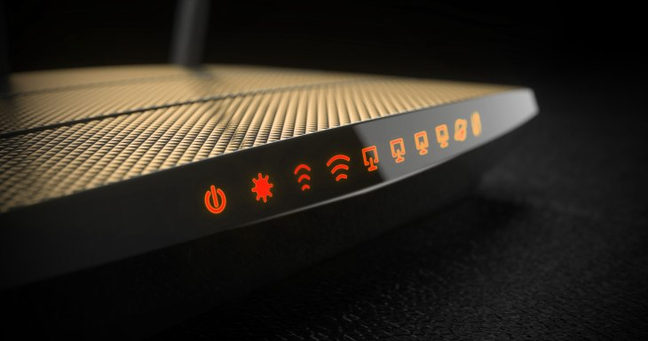 Wi-Fi wireless internet router on dark background