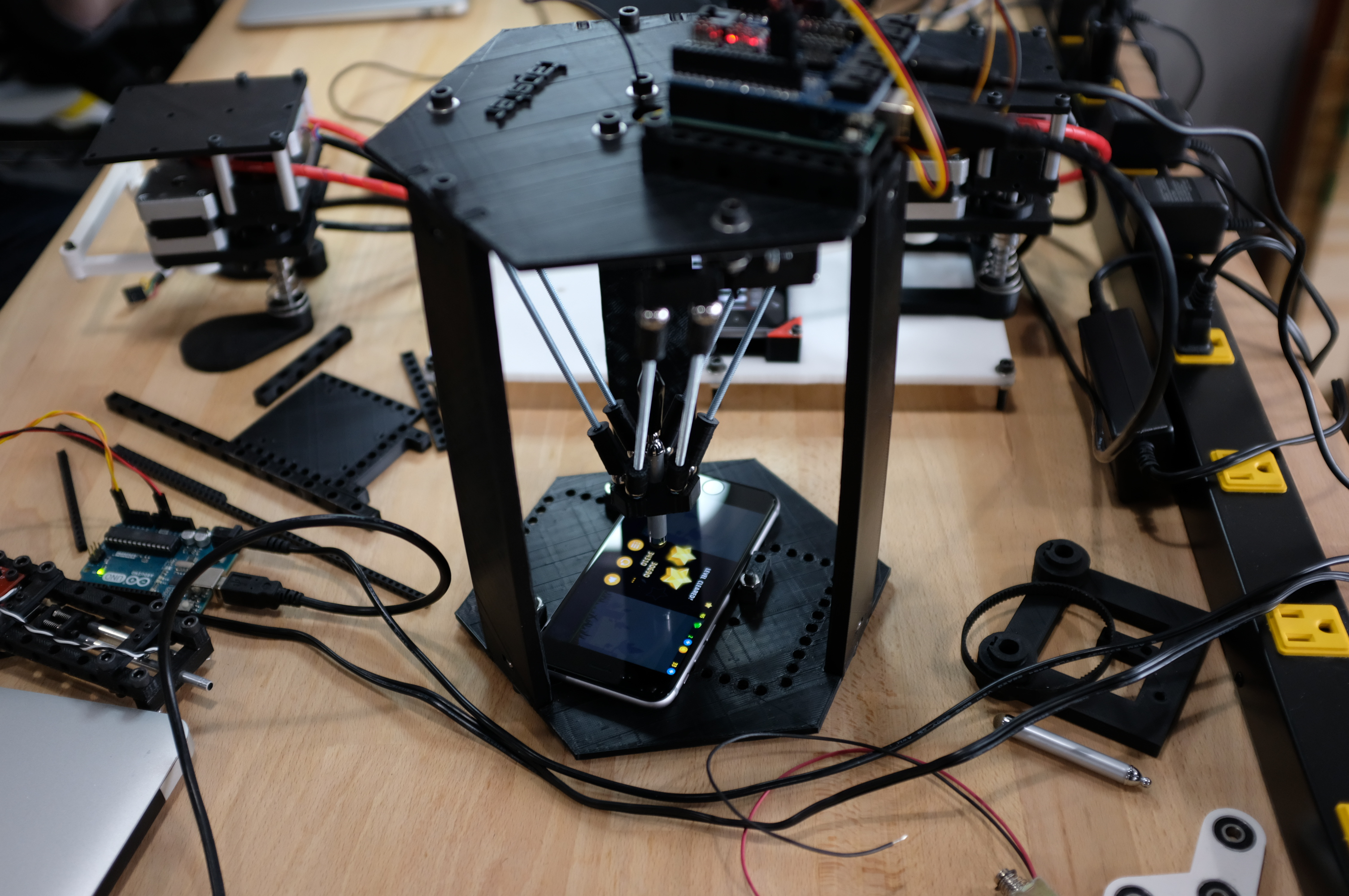 Tapster's robots are built to poke touchscreens
