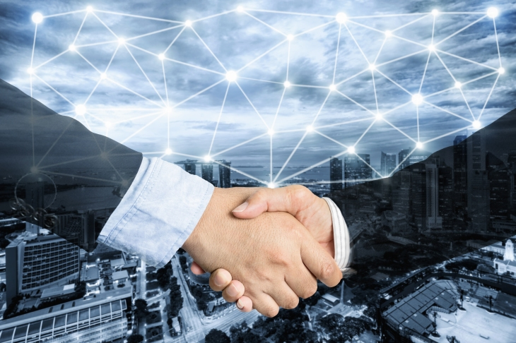 Deal or agreement business concept, handshake double exposure, coperation or partnership business with network connection.