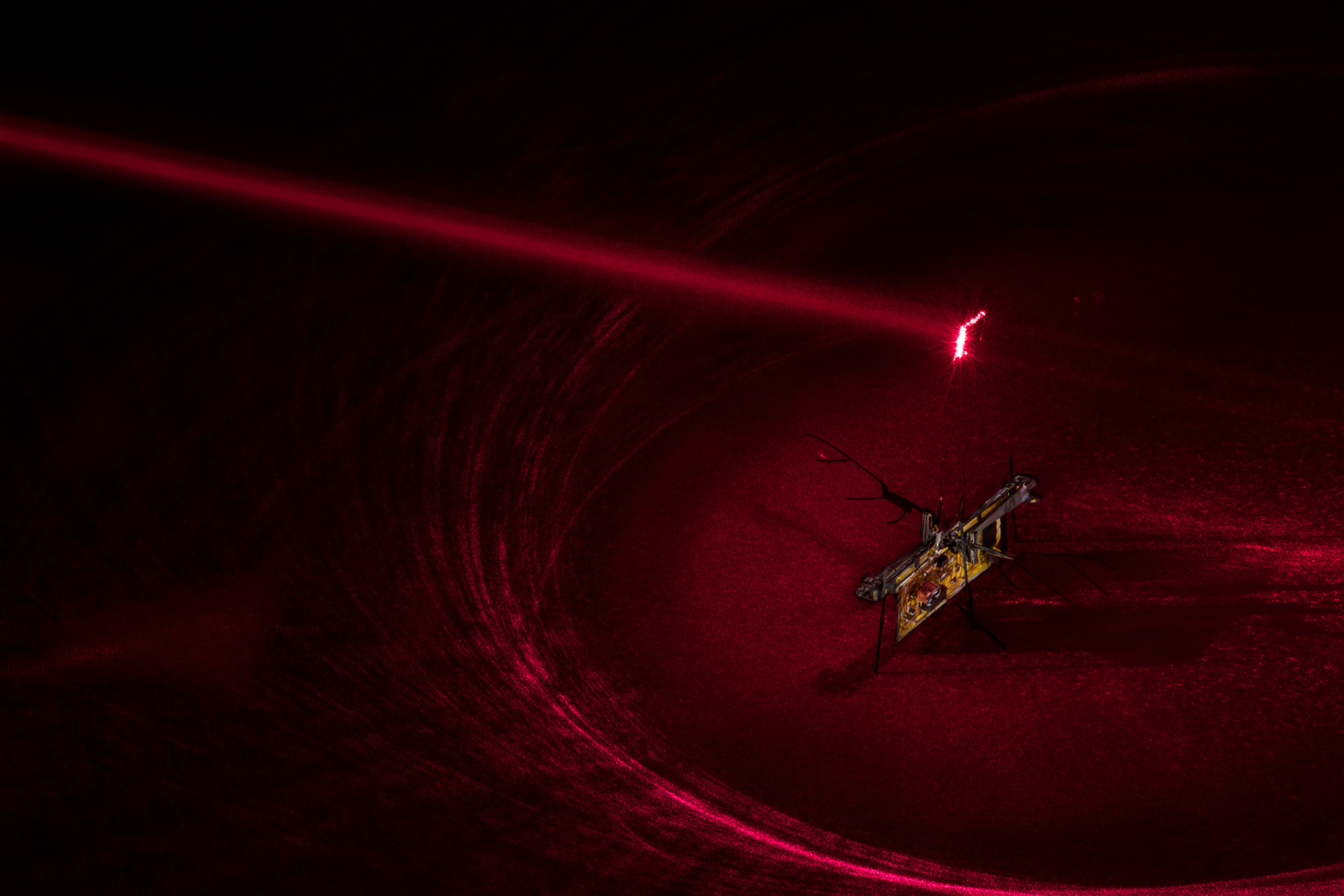 Watch a laser-powered RoboFly flap its tiny wings