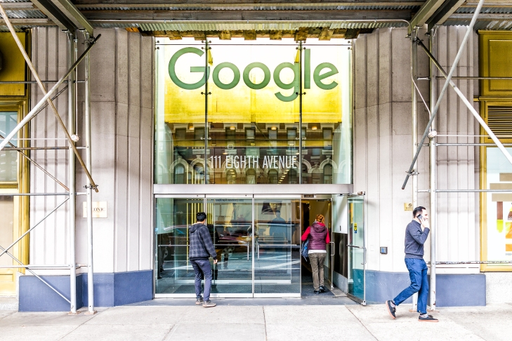 Google company office green sign in downtown lower Chelsea neighborhood district Manhattan NYC, people entering, exiting doors entrance