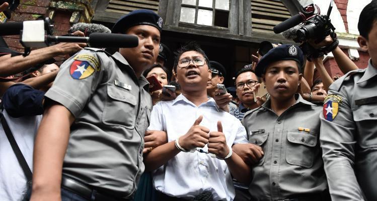 Myanmar jails Reuters reporters who uncovered military atrocity