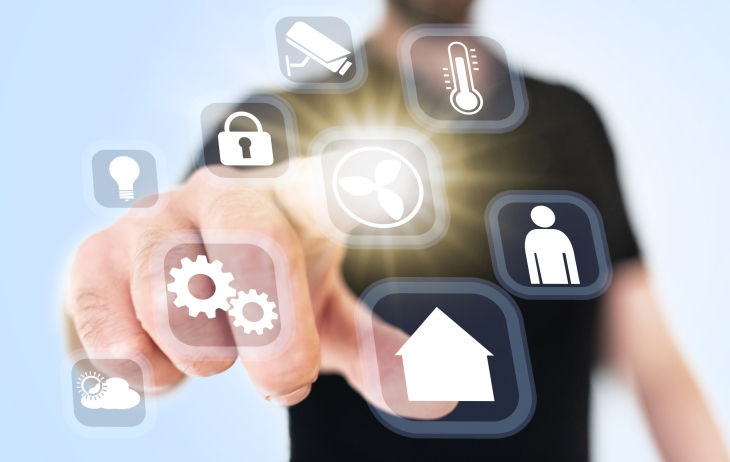 close-up of man using translucent smart home automation interface