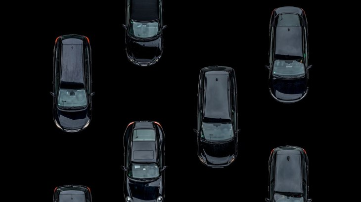 Black cars on black ground, Aerial View