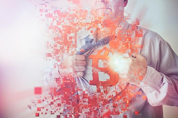Caucasian businessman opening shirt revealing Bitcoin symbol