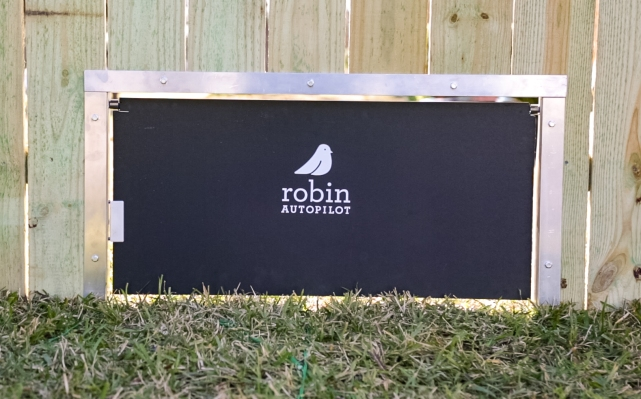 Robin's Robotic Mowers Now Have a Patented Doggie Door Just for Them