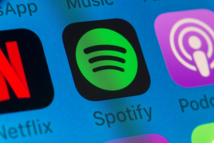 Spotify, Podcasts, Netflix and other cellphone Apps on iPhone screen