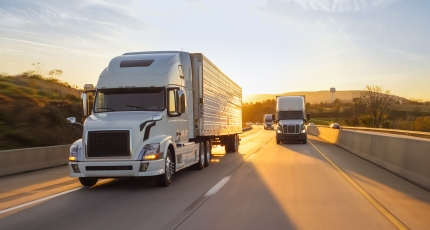 freight semi truck 18 wheeler sunrise on highway