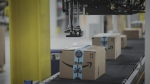 techcrunch.com - Henry Pickavet - How Amazon and Walmart are putting robots to work behind the scenes