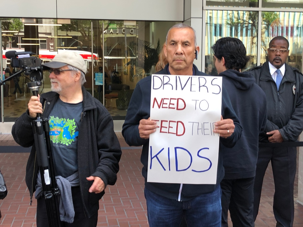 Uber and Lyft drivers demand better pay, workplace protections and driver-led unions