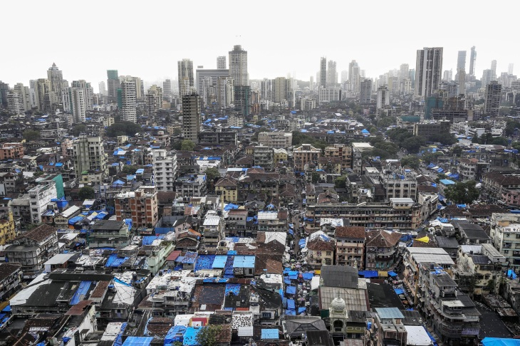 Residential and commercial buildings stand in the Bhendi Bazaar area of Mumbai